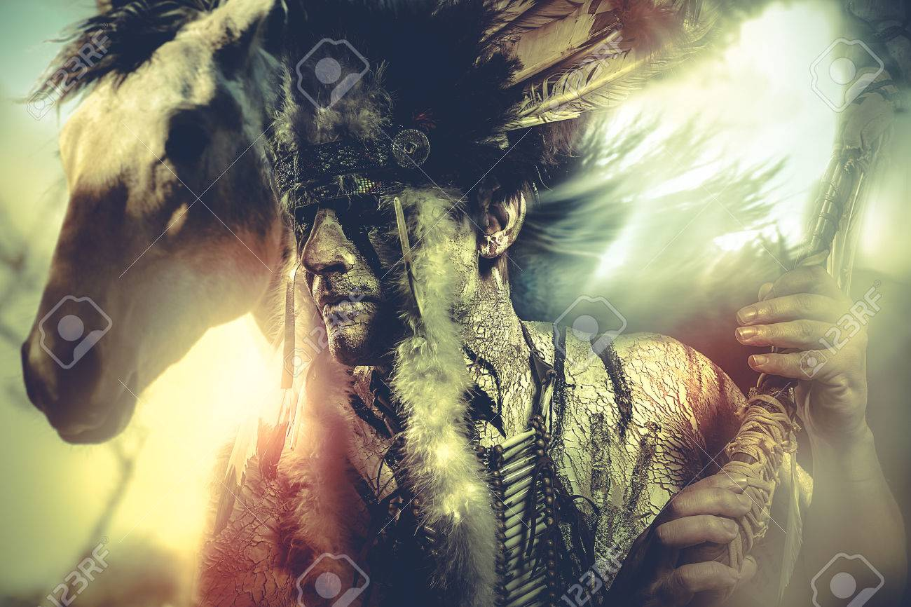 American Indian warrior, chief of the tribe. man with feather headdress and tomahawk, horse Stock Photo - 44484494