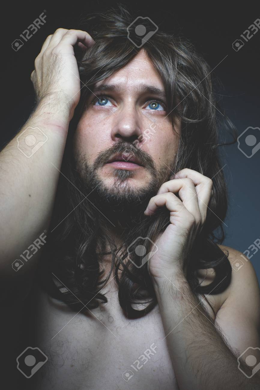 Sexy Naked Man With Long Dark Hair Intense Eyes And Blue Eyes Stock