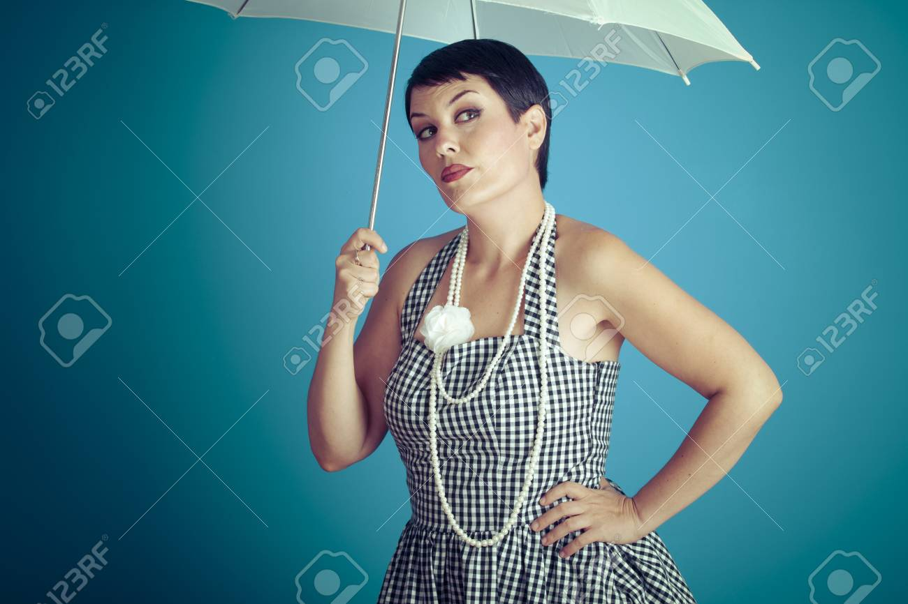 f94fd9c51b0 Freedom girl vintage 50s dress with white umbrella over blue background  Stock Photo - 50070528