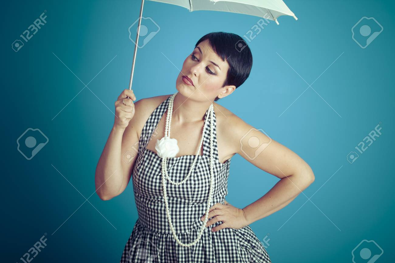 08b0fecd1f3 Pretty girl vintage 50s dress with white umbrella over blue background Stock  Photo - 50070661