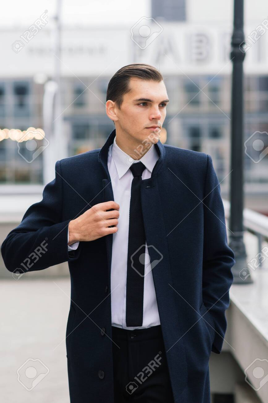 Man in a stylish suit. Businessman in an autumn city - 149261029