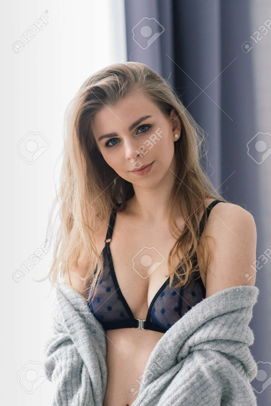 Beautiful and young woman posing in black lingerie. Vintage interior and retro background. - 159601629