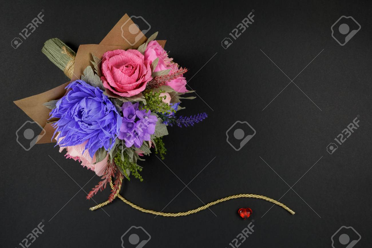 A Bouquet Of Colorful Paper Flowers And A Small Red Heart On Stock