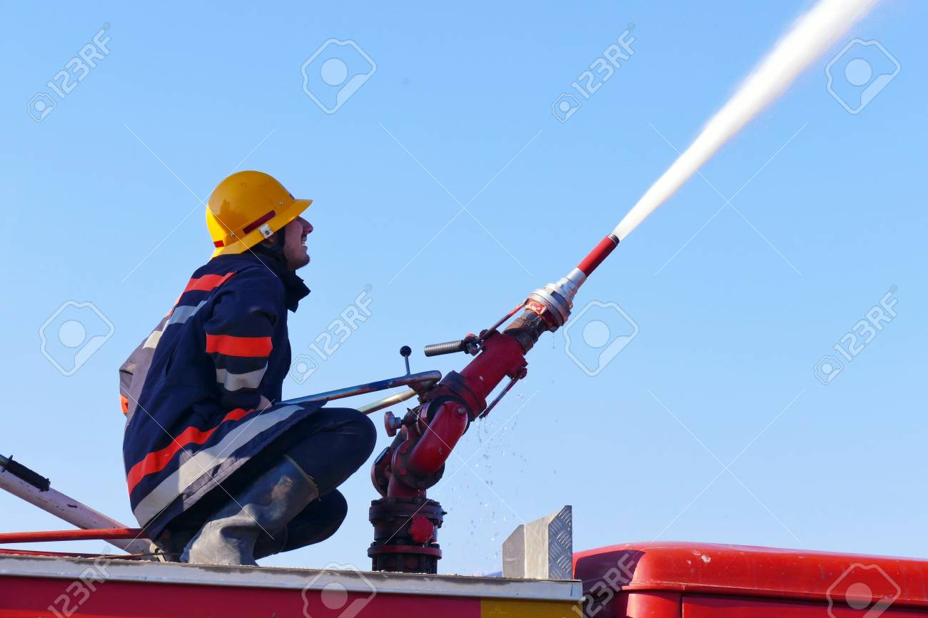 Fire fighting with water cannon /Firefighter with a water cannon
