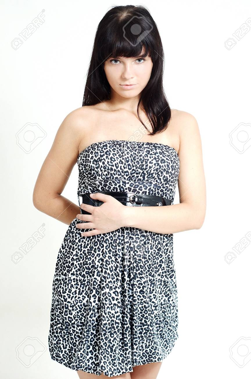 A nice brunette girl in a dress on a white background Stock Photo - 5532016