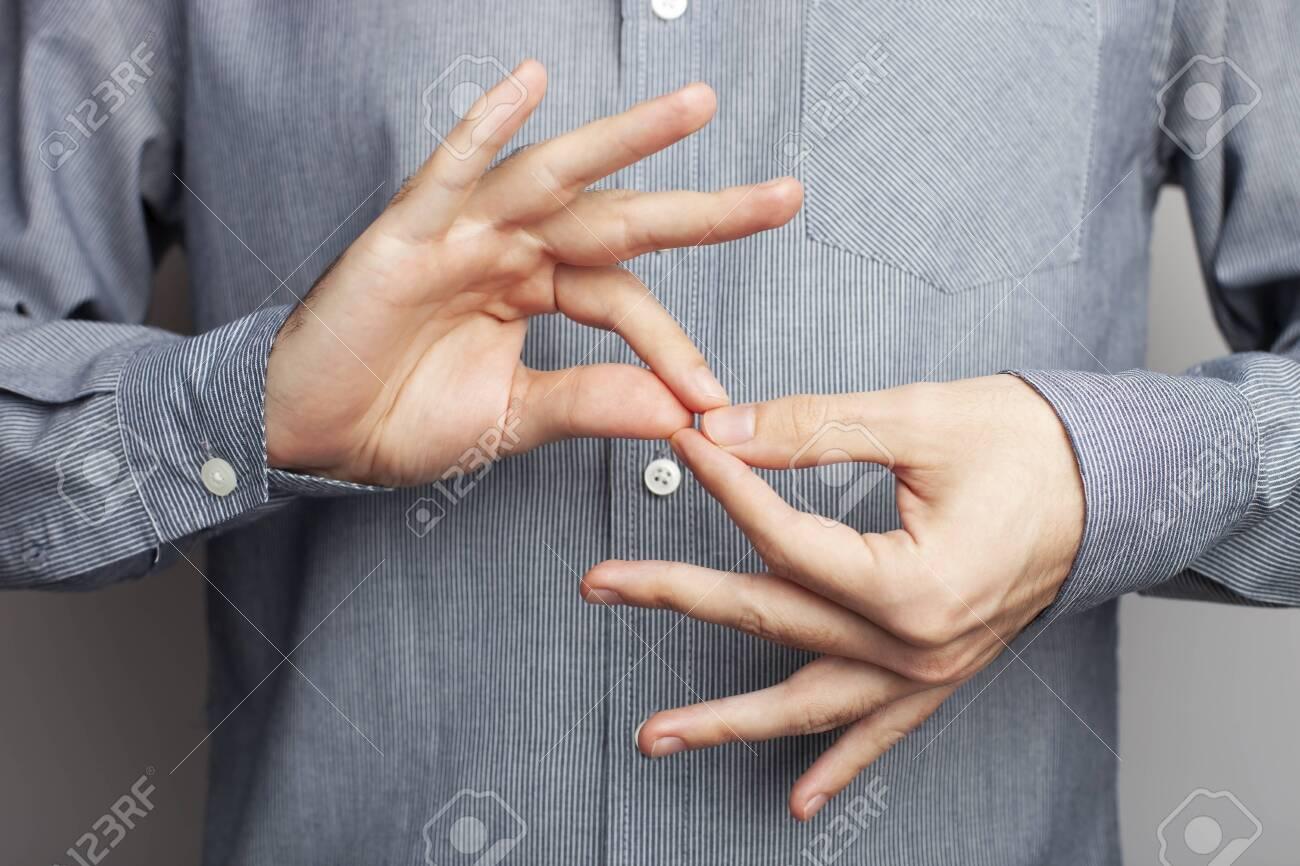 Man showing word interpreter, closeup view. American sign language - 134572916