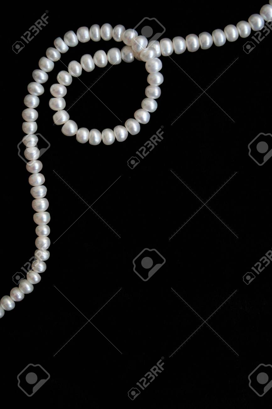 White pearls on the black silk as background Stock Photo - 6303220