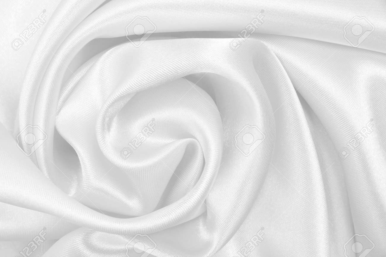 Smooth elegant white silk or satin luxury cloth texture can use as wedding background. Luxurious background design - 146297634