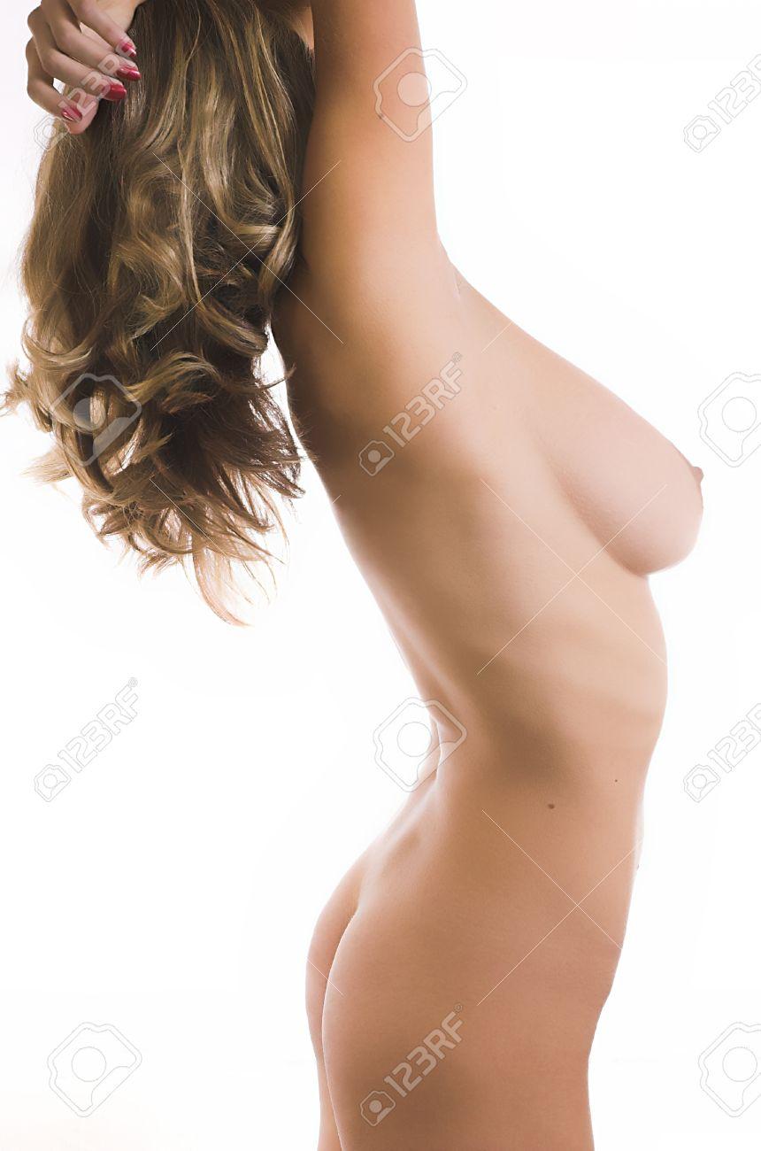 El hermoso cuerpo desnudo de la mujer sobre un fondo blanco  Foto de archivo - 1695191