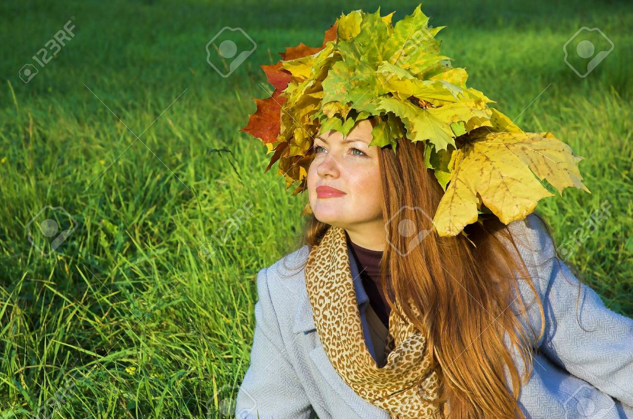 Portrait of the girl in a wreath from maple leaves Stock Photo - 1831607