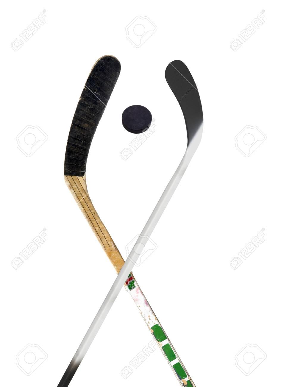 Hockey stick and puck on white Stock Photo - 14092168