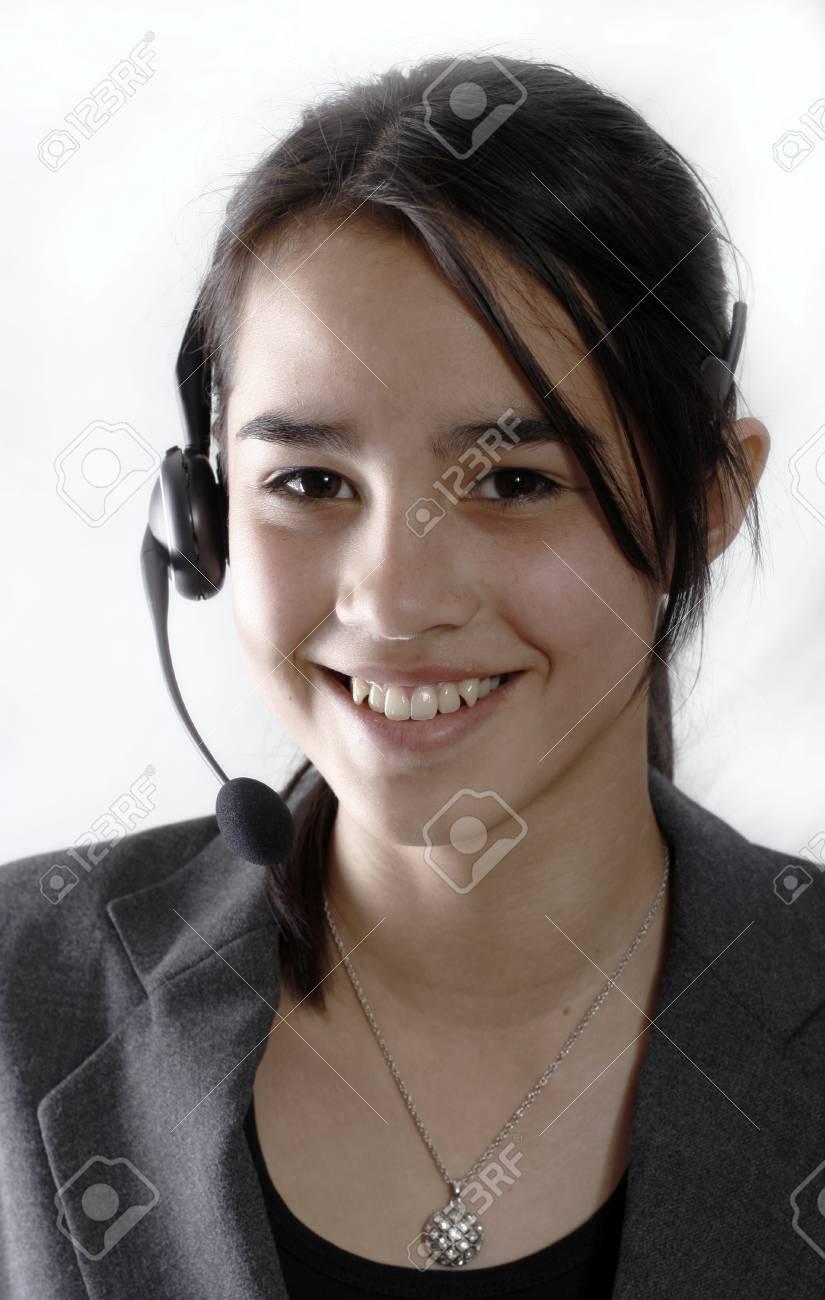 A friendly secretary/telephone operator at a call-center Stock Photo - 1416840