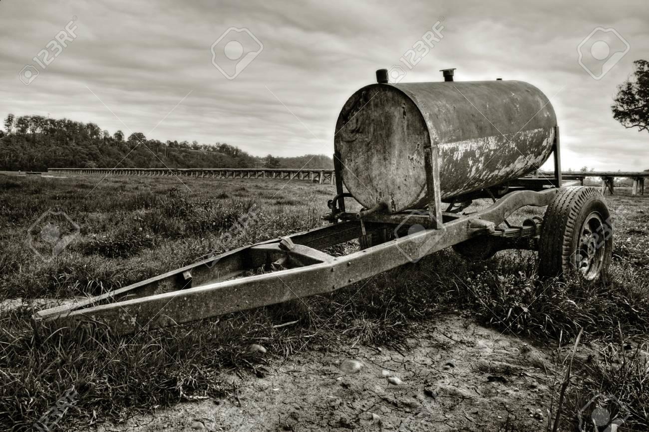 Rusty oil drum wagon on grass Stock Photo - 7173938