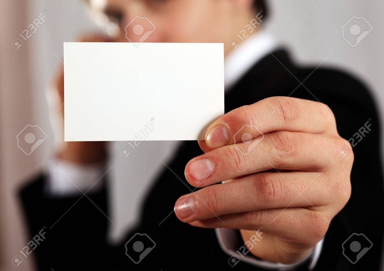professional man presenting blank business card Stock Photo - 9852093