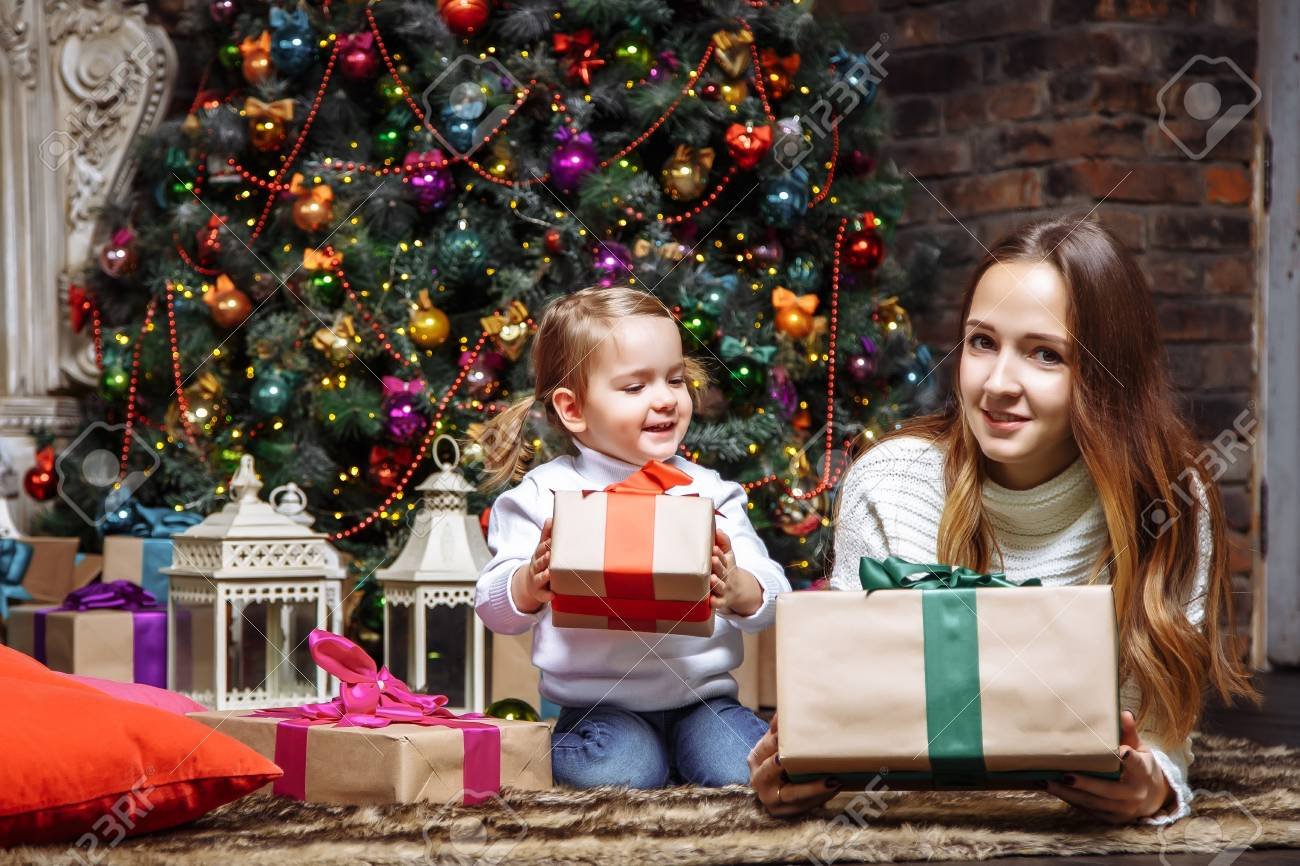 Happy Young Mother And Daughter With Christmas Gifts. Stock Photo ...