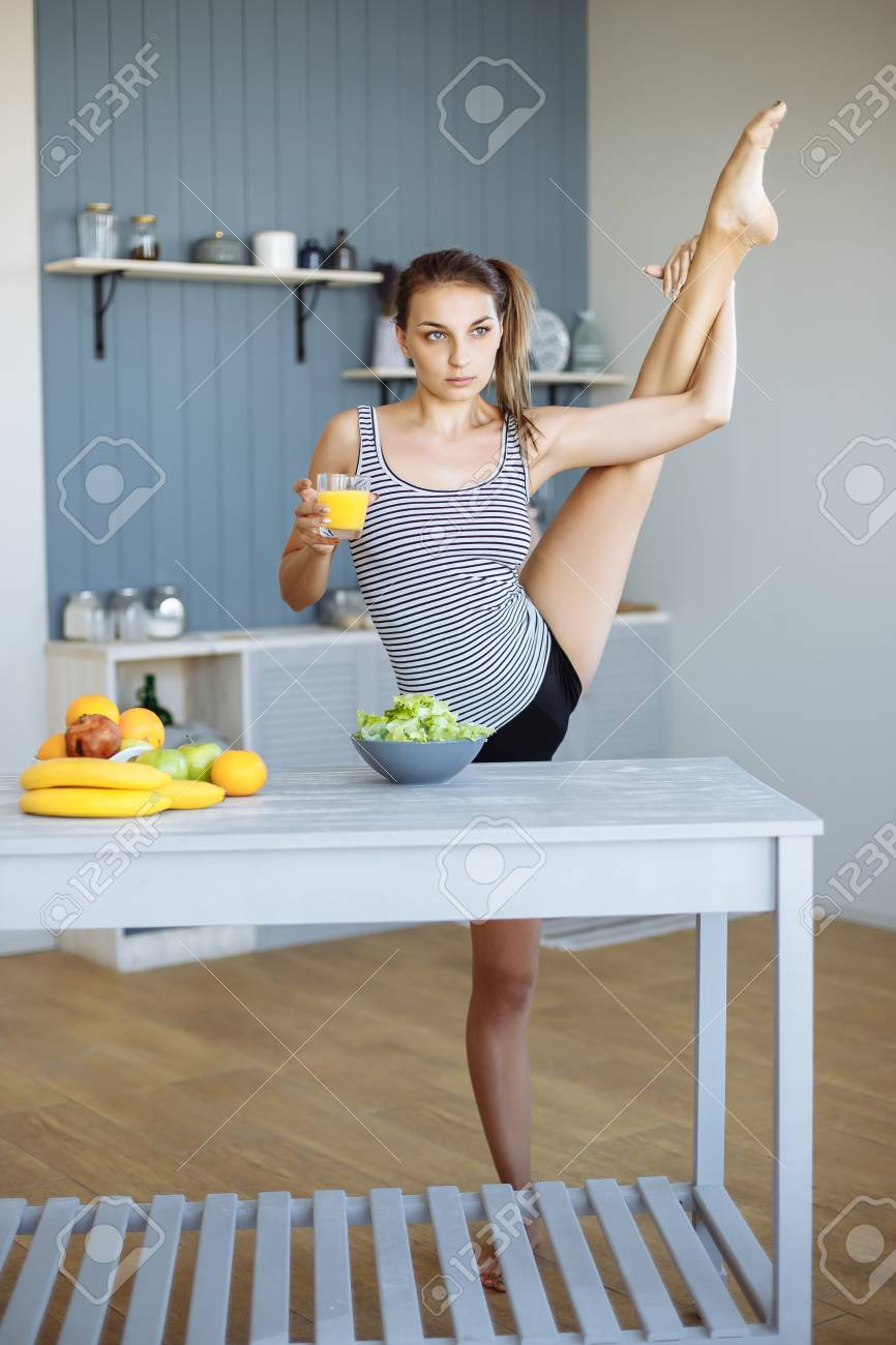Athletic Young Woman Doing Stretching In The Morning In The Kitchen ...