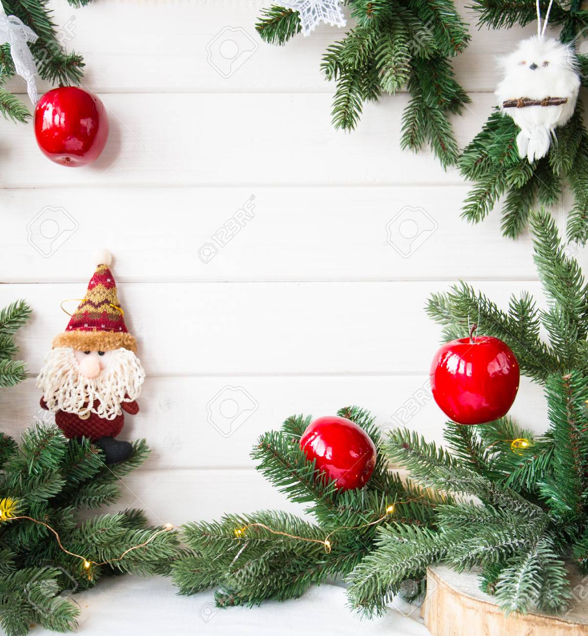 Christmas Tree Branches And Red Apples On White Wooden Background Stock Photo Picture And Royalty Free Image Image 90508170