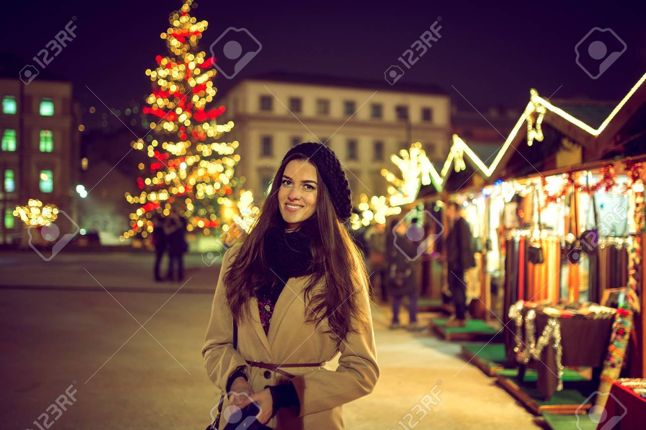 Christmas In Sarajevo.Pretty Young Adult Woman Standing In Christmas Holiday Market