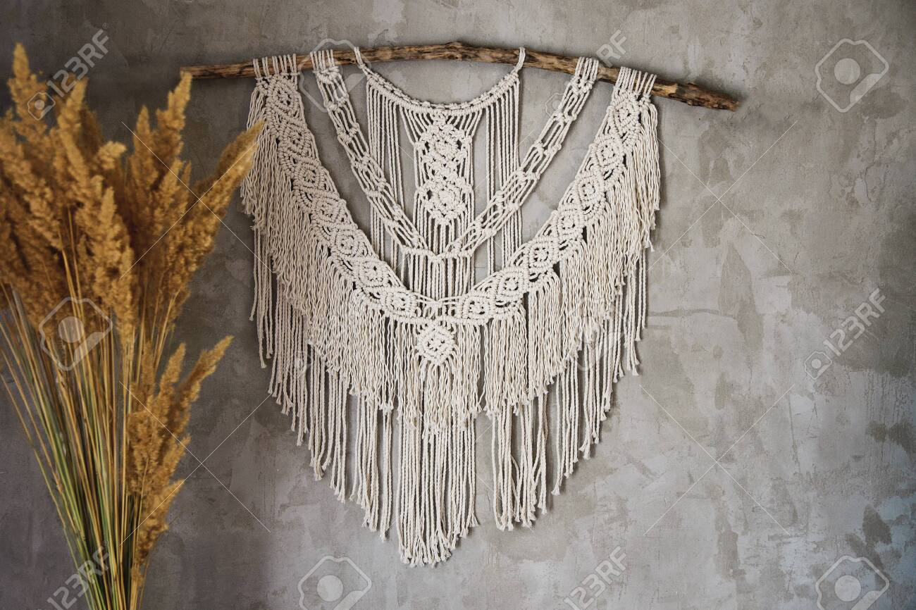 Wall panel in the style of Boho made of cotton threads in natural color using the macrame technique for home decor and wedding decoration. Beautiful boho macrame wall panel will add a cozy atmosphere and charm to any space in your home - 131995573