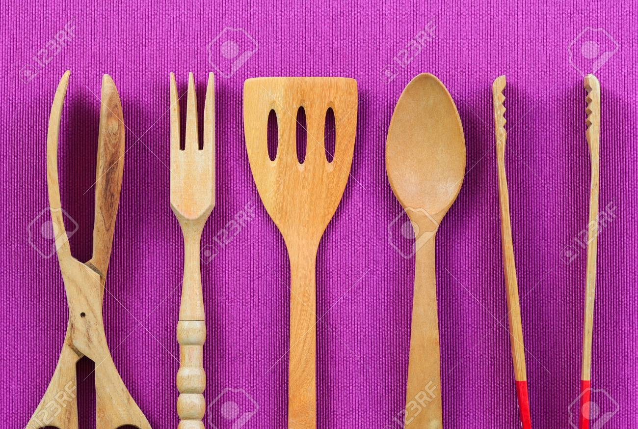 Isolated wooden kitchen utensils, Spoon, fork, clamp and flipper..