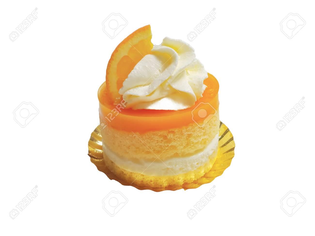 Orange Cake With Whipping Cream And Orange Topping On White Background