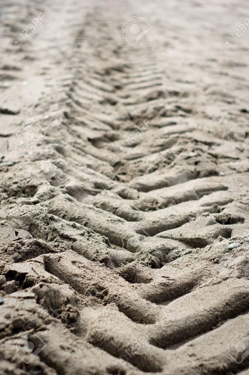 wheel traces on the beach Stock Photo - 12946152