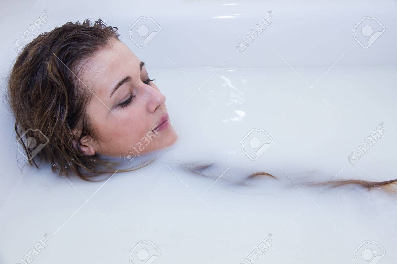 Portrait Photo Of A Blonde Girl With Blue Eyes Bathing In A Bathtub ...