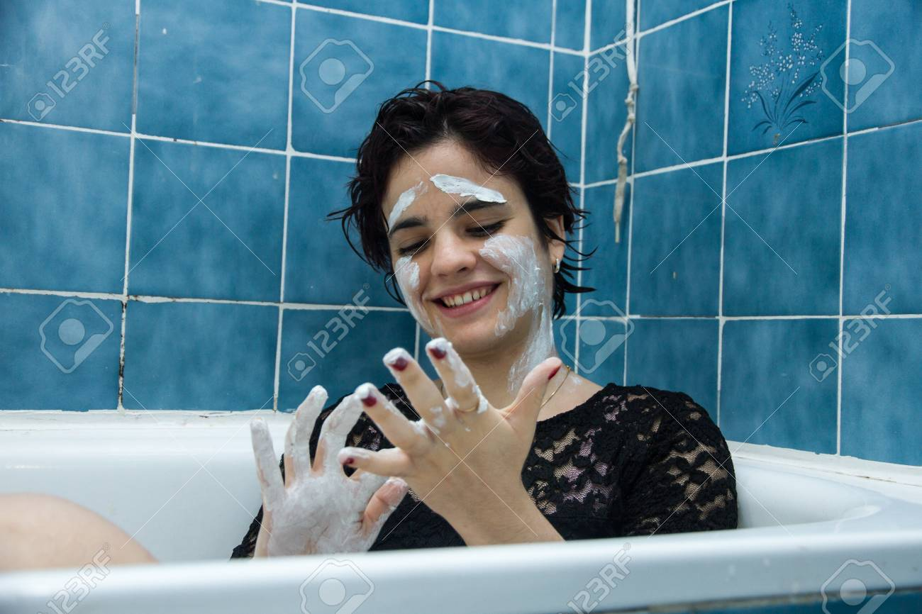 Girl With White Face Paint With Short Hair And Brown Eyes Bathing ...