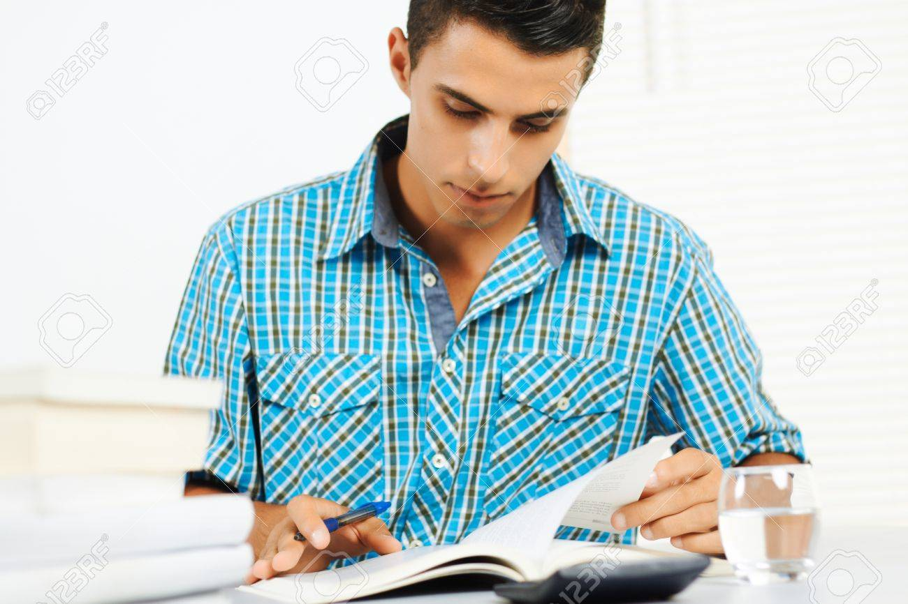 academic writing job academic writing young man reading and taking notes rf com academic writing young man reading and taking notes rf com