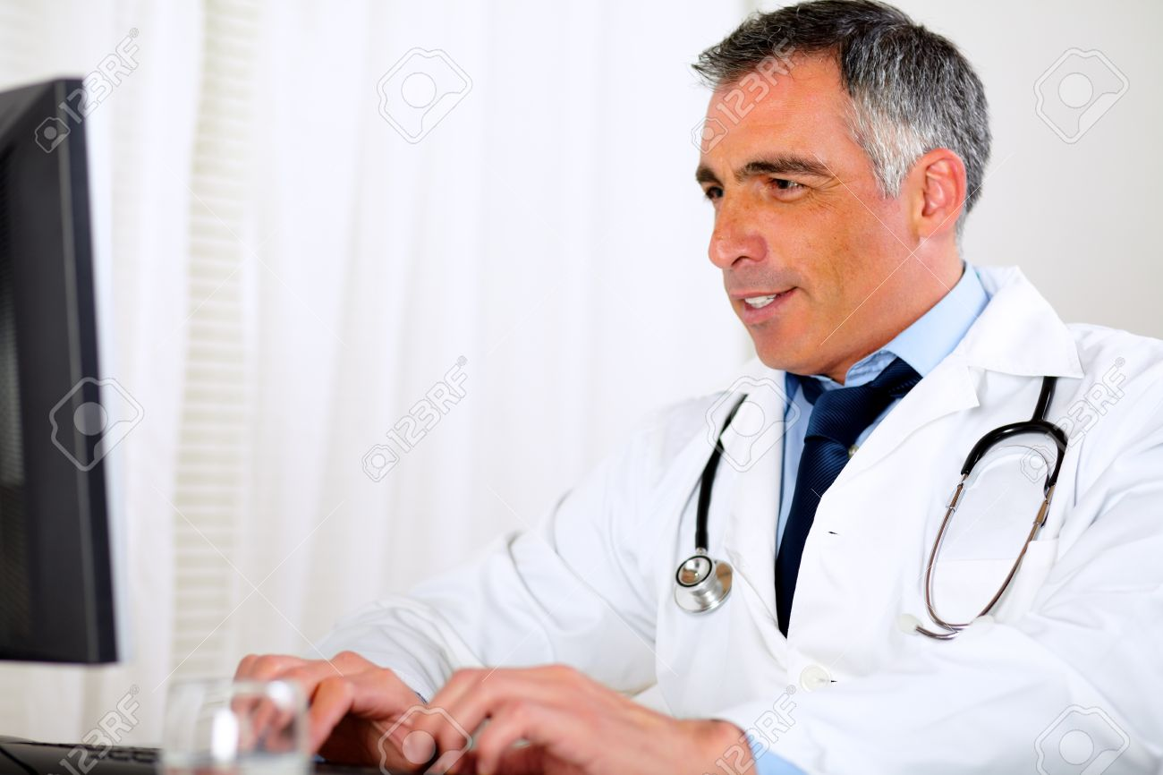 Portrait of a professional doctor using a computer at the hospital office Stock Photo - 13734389