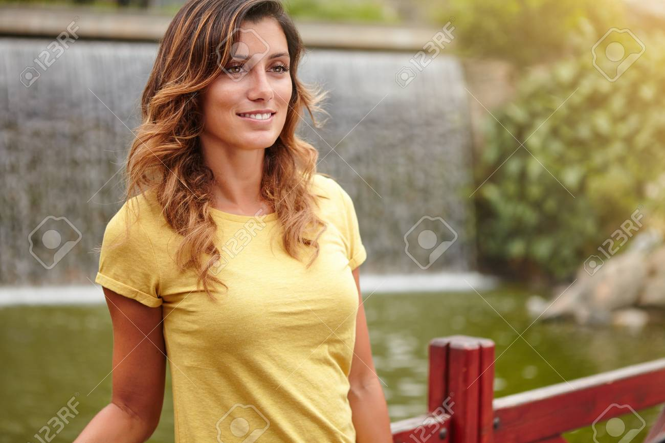 Young Lady With Medium Length Hair Smiling While Standing Near