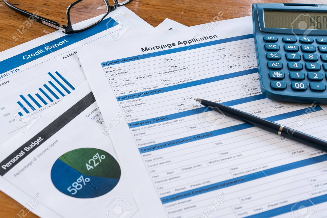 mortgage application on desk with credit report budget calculator