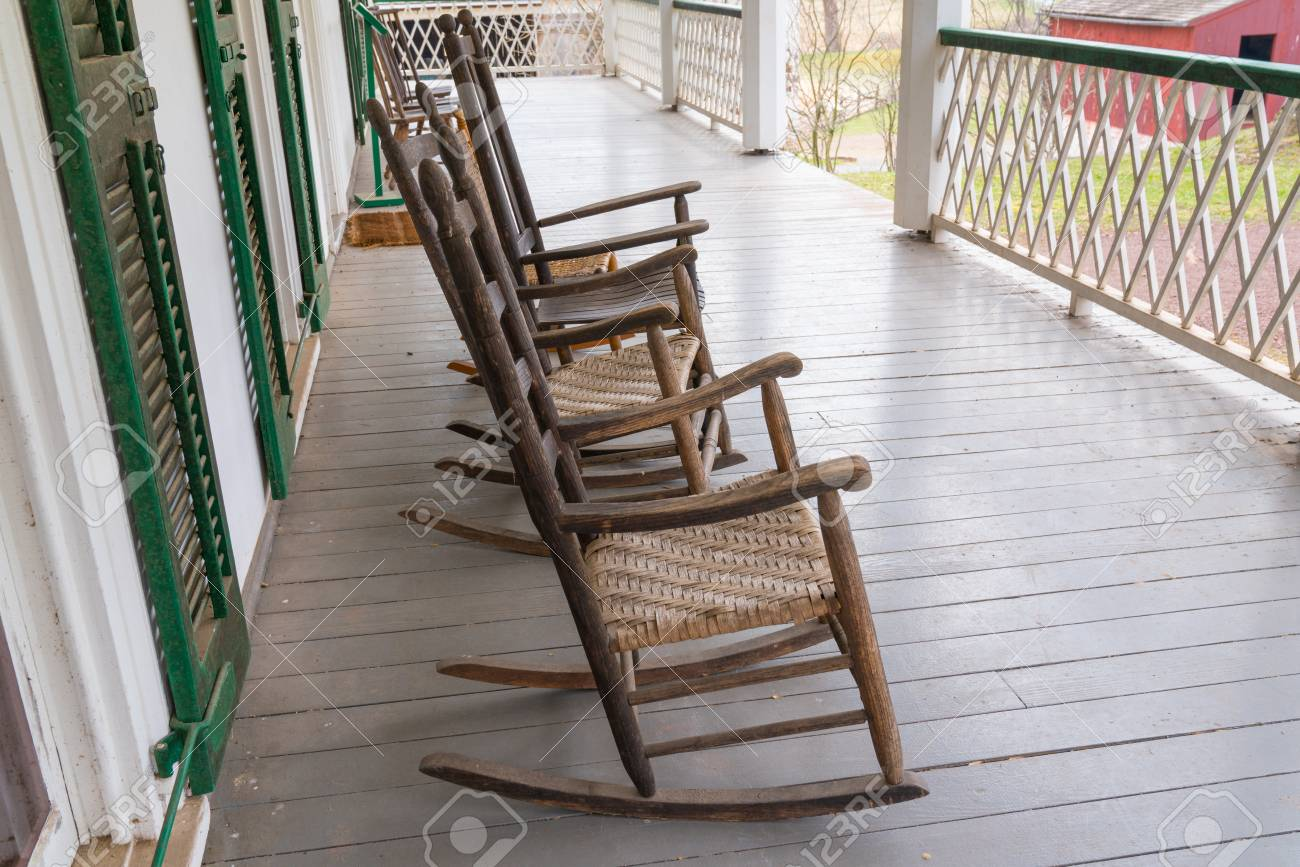 Sensational Old Wooden Rocking Chairs The On Porch Of A Farmhouse Ibusinesslaw Wood Chair Design Ideas Ibusinesslaworg