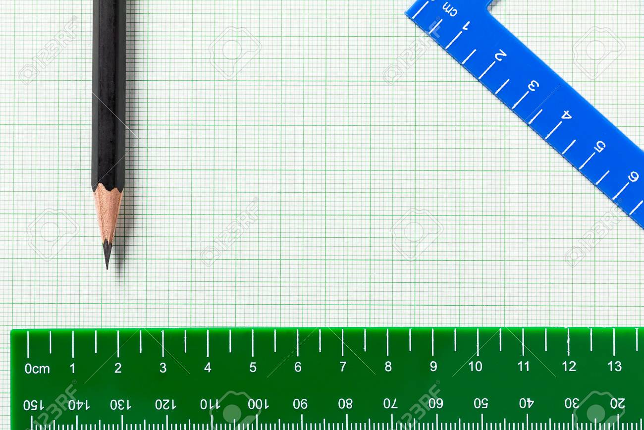 pencil and ruler on green graph paper with copy space stock photo