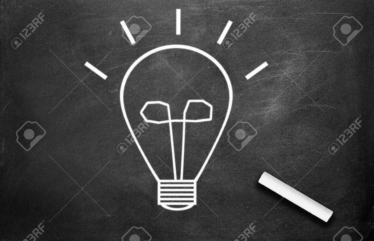 Chalk And Light Bulb Write On Chalkboard Background Stock Photo