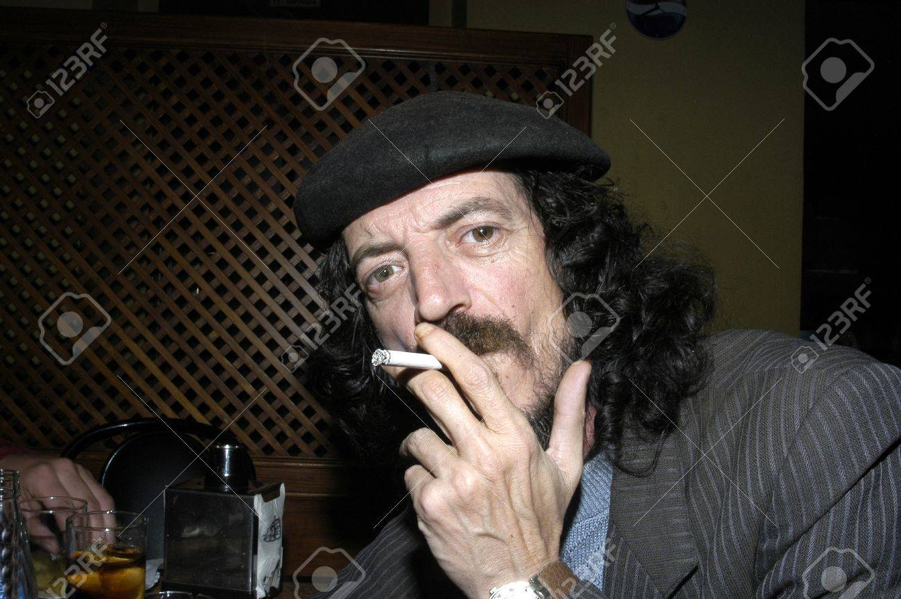Man with a beret smoking Stock Photo - 3966987