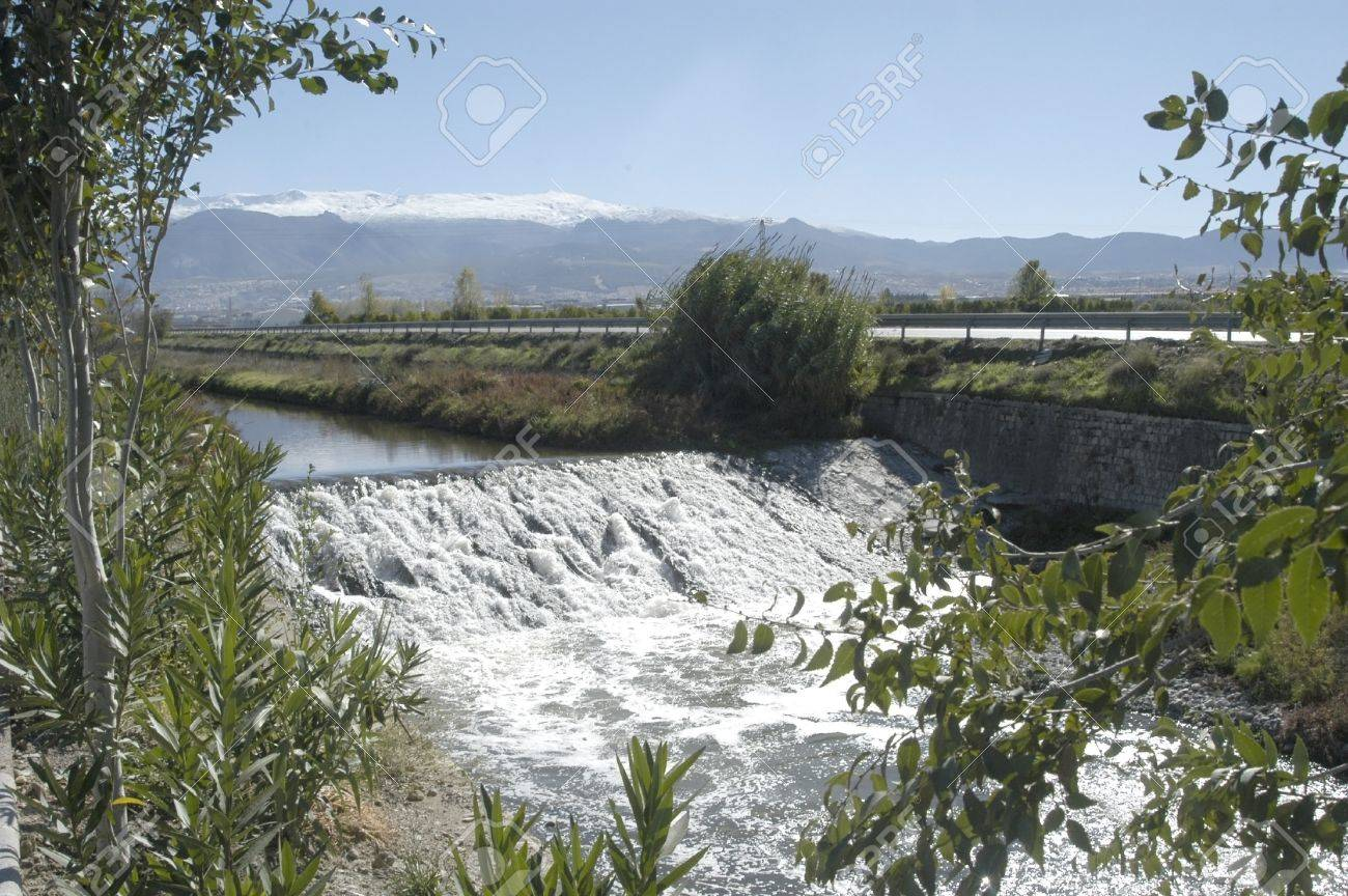 banks of the genil river, sierra nevada in the background. Stock Photo - 10519904