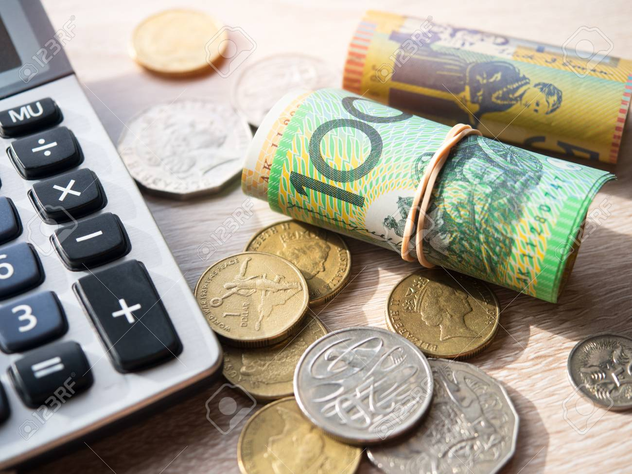 dollar australia banknotes and coins with calculator on table