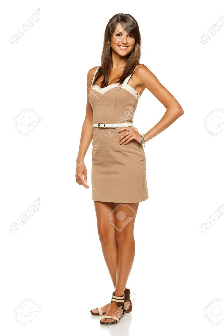 Full length portrait of trendy young woman in elegant beige dress smiling against white background Stock Photo - 15009760