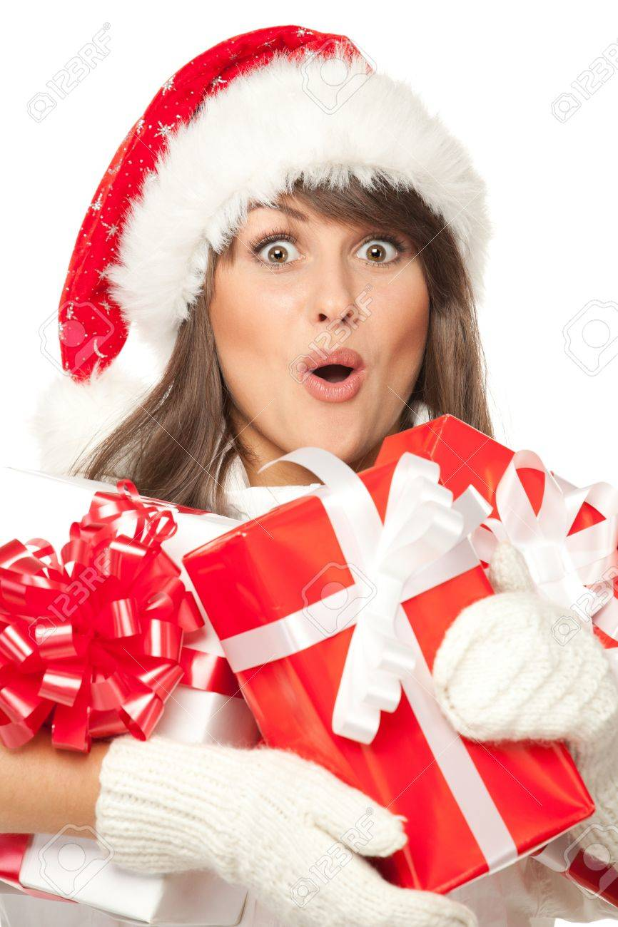 Closeup of a girl in Santa hat, surprised by having received a lot of Xmas presents, over white background Stock Photo - 15693225