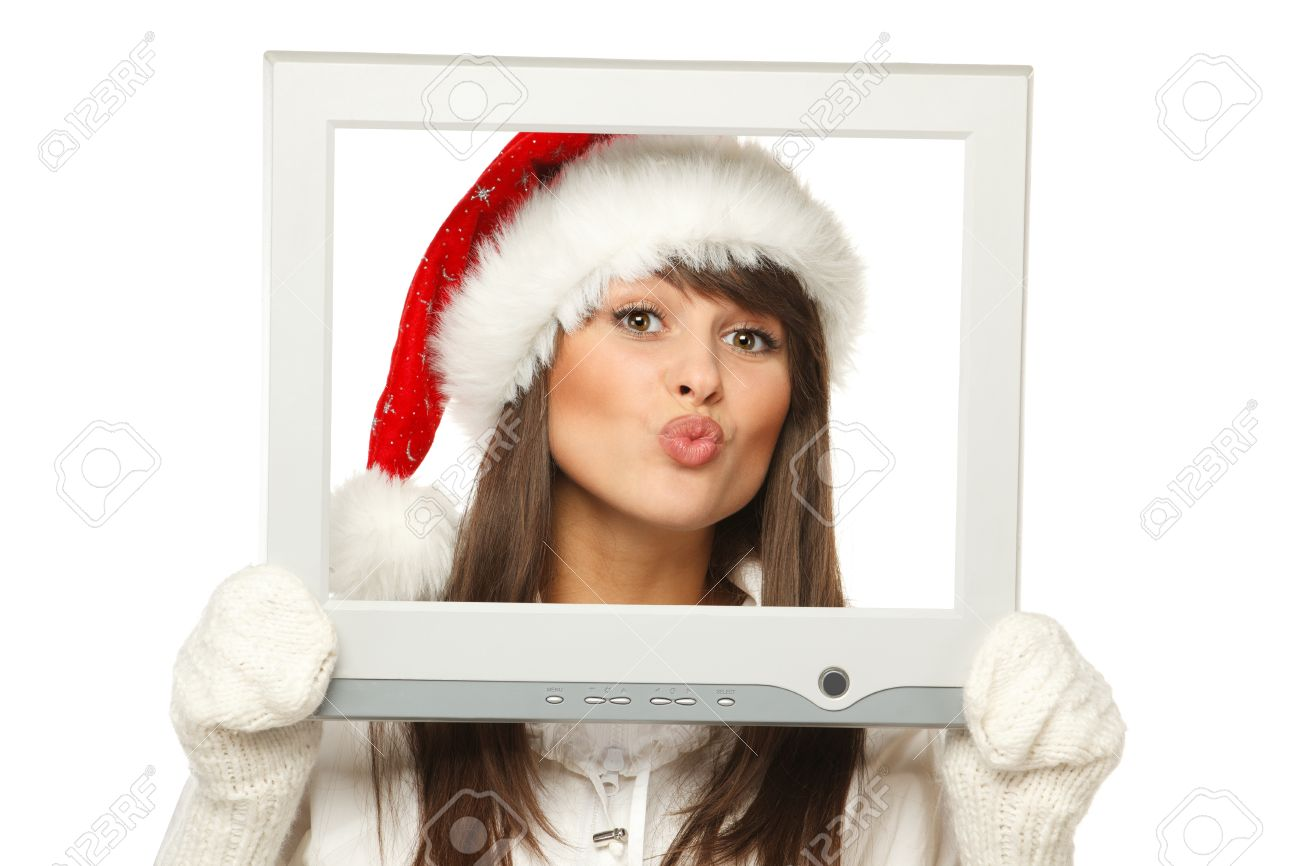 9e5b2fdc8e5c4 Girl in Santa hat sending you a virtual kiss from TV computer screen frame