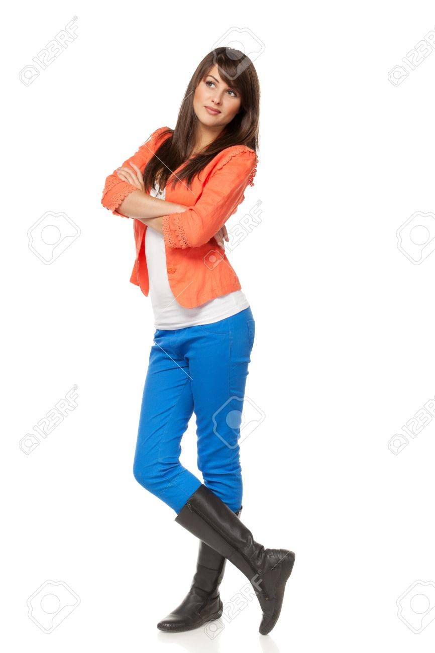 Full length of pensive young female looking up  into the corner at a copyspace over white background Stock Photo - 15693282