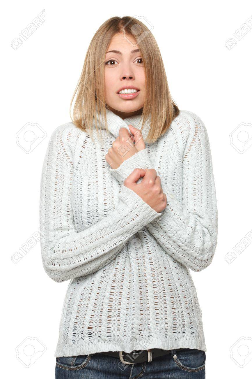 Portrait of attractive young woman shivering in the cold on white background Stock Photo - 16031335