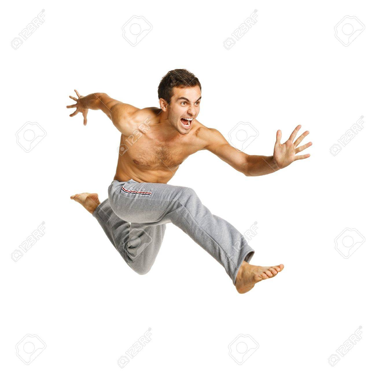 Full length of a male flying against white background Stock Photo - 16733320