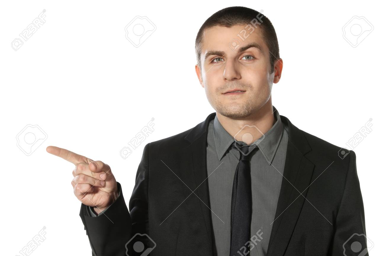 Close up of young business man pointing at copy space over white background Stock Photo - 17281712