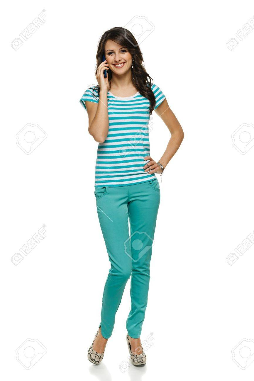 Young woman in full length talking on cellphone, over white background Stock Photo - 17537471
