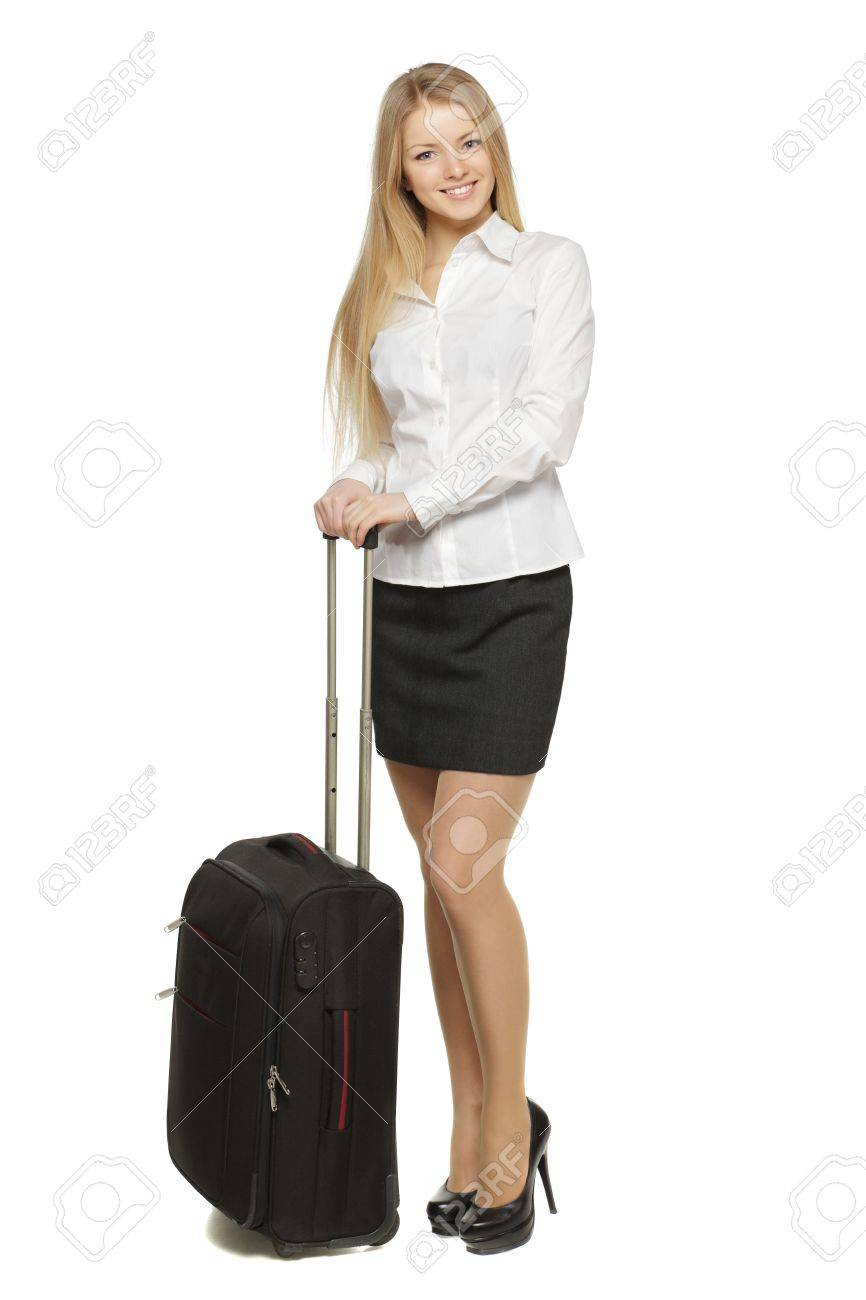 Full-body portrait of young business woman standing with black travel bag isolated on white background Stock Photo - 17861708