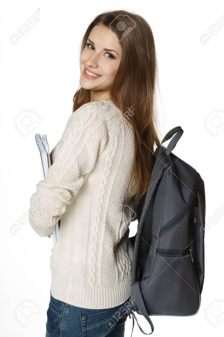 Happy young woman wearing a backpack and holding notebooks ready to go to class, over white background Stock Photo - 18183258