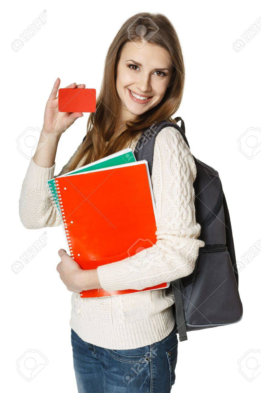 Happy young woman wearing a backpack and holding notebooks showing blank credit card, over white background  Student loan concept Stock Photo - 18183249