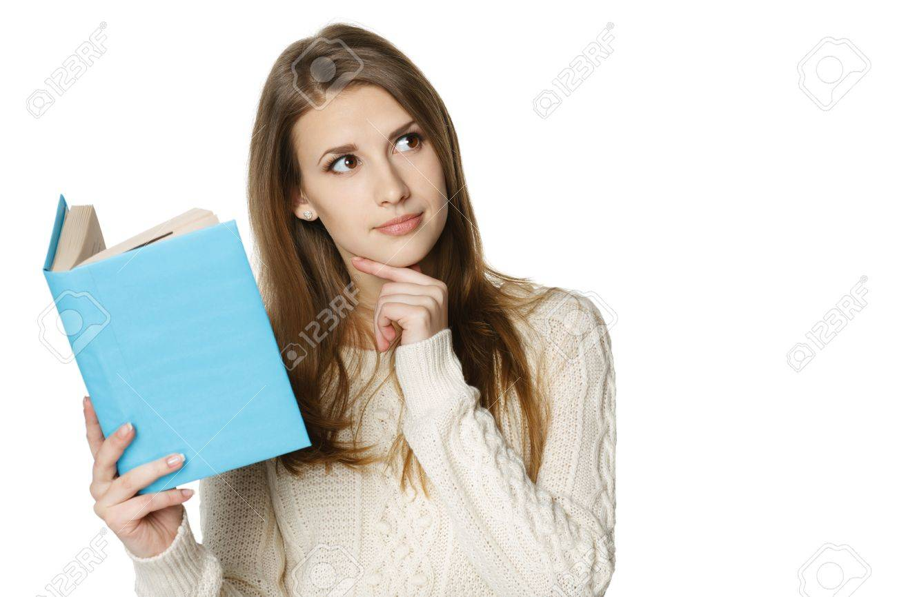Closeup of thinking woman holding opened book and looking at the blank copy space, over white background Stock Photo - 18183218